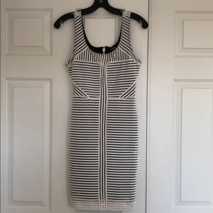 Form fitted, black and white striped mini dress.